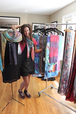 COLOR ME HAPPY :  ColorVibe Design's Sharon Gellerman blends in with her silk scarves on display. - PHOTO BY REBECCA LUCAS