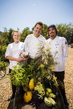 SO FRESH, SO GREEN:  From left to right, Gardens at Avila Baker Chelsea Freeland, Executive Chef Gregg Wangard, and Sous Chef Michael Avila are backed by the greenery of the restaurant's 1.5 acre onsite garden. With an abundance of fresh produce and herbs at his fingertips, Chef Wangard has free license to play up local dishes with vibrant abandon. - PHOTO BY HENRY BRUINGTON