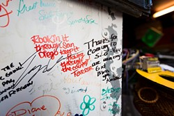 WRITING ON THE WALL:  Fans from across the country, both young and old, have taken to Jeffrey's unique act, writing their well wishes on the wall of his truck. - PHOTO BY KAORI FUNAHASHI