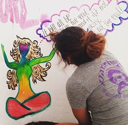 "IT'S A PROCESS:  Venegas works on an acrylic painting titled ""Colors Within."" - PHOTO COURTESY OF VANESSA VENEGAS"