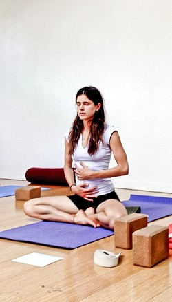 INNER GODDESS:  Class instructor Alycia (Maia) Kiley demonstrates one way to ease your period troubles that isn't heavily medicating yourself with Midol. - PHOTO BY JESSICA PENA