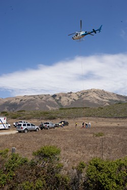 HIGH FLYING WEED:  A California Highway Patrol helicopter dropped off bundles of marijuana found at a remote beach near Piedras Blancas for Sheriff's Department trucks to haul them off to the sheriff's headquarters. - STEVE E. MILLER