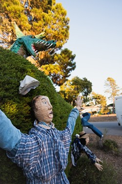 SCARE BRO:  'Hedge Creatures,' created by Haak Pearson and Sharon Vaughan and sponsored by Cambria Pines Lodge, features a towering dragon, - with scales fashioned from paper plates. - PHOTO BY KAORI FUNAHASHI