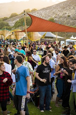 PARTY ON!:  The crowds were in good spirits and well fed and lubed! - PHOTO BY HENRY BRUINGTON