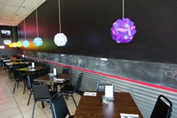 A GREAT PLACE TO PARK:  The new restaurant, complete with truck tire installed in bar and joyful colored lights, reflect Nunes' energetic personality and vibrant Asian fusion creations. - PHOTO BY TOM FALCONER