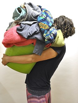 PILE-UP! :  Doing laundry is a drag. Get it done, and do it well by following this guide. - PHOTO BY CAMILLIA LANHAM
