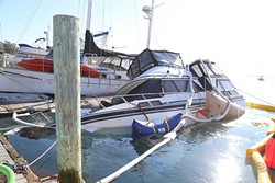 """VESSEL SUNK:  A 38-foot boat sunk at the Bay Front Marina in Morro Bay on Nov. 30. The cause of the sinking was a """"through hole"""" that officials haven't been able to determine the reason behind. Rescue efforts to get the boat above water were ongoing as of Dec. 2. - PHOTO BY DYLAN HONEA-BAUMANN"""