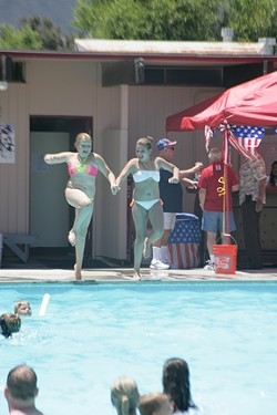ONE, TWO, THREE! :  Two young girls leapt in tandem into the SLO Elks Lodge pool. - PHOTOS BY GLEN STARKEY