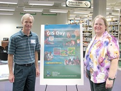 MAPPING THE FUTURE :  Andy Richardson, a Caltrans employee and chair of the GIS User Group, and Carol Schuldt, the GIS resources coordinator at the Kennedy Library at Cal Poly, explained the uses of GIS at last year's event - PHOTO COURTESY CAL POLY