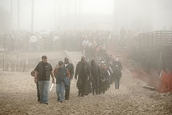 OUT OF THE MIST :  Hundreds of dangerous badasses managed to walk in single file and behave themselves. Good bikers! - PHOTO BY STEVE E. MILLER
