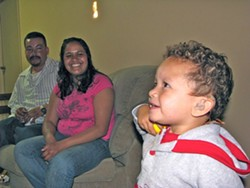 AN AMERICAN DREAM :  Jose and Bibiana Ruiz are learning two new languages—ASL and English—to communicate with their deaf toddler, Angel. - PHOTO BY WENDY THIES SELL