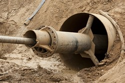 PIPELINE, LIFELINE?:  Water from the Nipomo Supplemental Water Project (pictured here under construction) is scheduled to start flowing sometime in 2015. Though the project will bring relief for the depleted Santa Maria Groundwater Basin, some say it isn't enough. - FILE PHOTO BY STEVE E MILLER