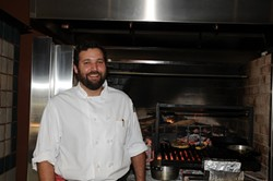 FLAMIN':  Chef Brian Collins brings a taste of Chez Panisse to South County in his new restaurant Ember where nearly everything is cooked over flaming oak. - PHOTO BY DAN HARDESTY
