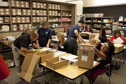 PAPER TRAIL :  Democracy is sexy, there's no doubt about it. But it also involves a lot of paperwork, with 40 volunteers spending about 160 hours counting ballots. - PHOTO BY STEVE E. MILLER