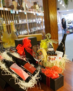 WINE GIFTS GALORE :  Thanks to all the local wine shops, gift givers have a wide choice of items sure to please wine lovers. - PHOTO BY STEVE E. MILLER
