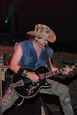 THE HUMAN TORNADO! BE SWEPT UP IN TED NUGENT'S RIPPING GUITAR AND RIGHTWING RHETORIC AT POZO SALOON ON JUNE 13. :  Be swept up in Ted Nugent's ripping guitar and rightwing rhetoric at Pozo Saloon on June 13. - PHOTO COURTESY OF DUANE SYCZ