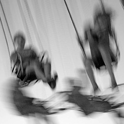 """WHEEEEEE! :  Like much of Tom Peck's work, in many of """"The Midway"""" photos there's an inherent sense of movement, a kinetic energy in his subjects. - PHOTO COURTESY OF TOM PECK"""