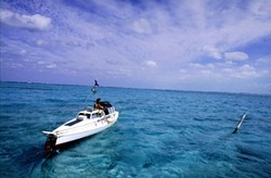 MODERN MAGELLAN :  Jason Lewis, author of the The Expedition trilogy, leaves the Turks and Caicos islands in his pedal boat Moksha. - PHOTO BY KENNY BROWN