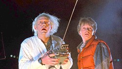 GREAT SCOTT!:  Dr. Emmett Brown (Christopher Lloyd, left) and Marty McFly (Michael J. Fox) work together to send Marty 30 years in the past to make sure his parents meet in high school and fall in love, in Back to the Future. - PHOTO COURTESY OF UNIVERSAL PICTURES AND AMBLIN ENTERTAINMENT