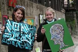 ORIGINALS :  Becky Griswold and Maggie Nichols clutch their first pieces of original art. - PHOTO BY GLEN STARKEY
