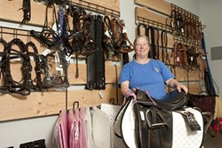 PLETHORA OF LEATHER :  At The Tack Room in Paso Robles, Laurie Ridgeway showcases many of her products available for all you cowboys and cowgirls out there. - PHOTO BY STEVE E. MILLER