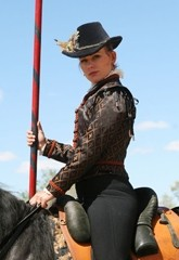THE LADY KNIGHT:  Katrina Saunders, a member of the jousting troupe Knights of the Crimson Rose, will display her mad jousting skills July 20 and 21 at the Central Coast Renaissance Festival. - PHOTO COURTESY OF RICK SMITH
