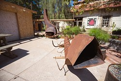 HARMONY DINING :  A new restaurant featuring Italian-Swiss eats is slated to open next spring in the old dairy community of Harmony. Pictured, repurposed metal will be used to create interesting and inviting fireplaces for a rustic outdoor patio. - PHOTO BY KAORI FUNAHASHI