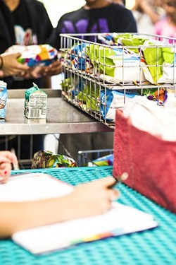 FREE LUNCH:  Kids receive free lunches this summer from the Lovin' Lunchbox program, hosted by the Food Bank Coalition. - PHOTO BY HENRY BRUINGTON