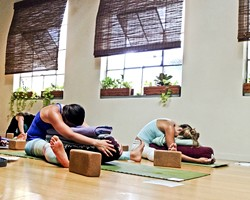 GO WITH THE FLOW:  For one of the more entertaining Art Bash articles this year, new Arts Editor Jessica Peña donned an Australian accent during a yoga session themed around menstrual cycles. - PHOTO BY JESSICA PEÑA