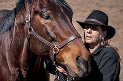 LONE WRITER :  Cambria-based author Catherine Ryan Hyde named her horse Nathan after the steadfast and loyal character of the same name in her book, 'When I Found You.' - PHOTO COURTESEY OF HUNTER KILPATRICK