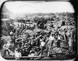 OLD MINE RIVER:  Miners at work on the American River, 1852. - PHOTOGRAPHER UNKNOWN; COLLECTION OF THE CALIFORNIA STATE LIBRARY