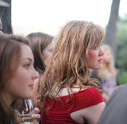 A FACE IN THE CROWD :  One of Joe's models looks on with rapt attention. - PHOTO BY GLEN STARKEY
