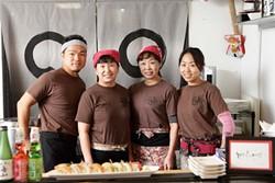 READY TO ROLL :  The friendly staff at Izakaya Raku in Grover Beach includes (left to right) Tony Yoshida, Euu San, Shigeko Yoshida, and Chie Yoshida, preparing and serving (clockwise from top right) salmon sahimi, rainbow roll, crispy rice spicy tuna, appetizer sampler, and yaki soba (stir-fried noodles). - PHOTO BY STEVE E. MILLER