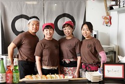 READY TO ROLL :  The friendly staff at Izakaya Raku in Grover Beach includes (left to right) Tony Yoshida, Euu San, Shigeko Yoshida, and Chie Yoshida, preparing and serving (clockwise from top right) salmon sahimi, rainbow roll, crispy rice spicy tuna, appetizer sampler, and yaki soba (stir-fried noodles). - PHOTO BY STEVE E. MILLER