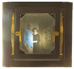 KICKING IT, 18TH CENTURY :  This is photographer Jim Vincolisi and wife Patricia Bennett, owners of the B-W Gallery, as seen through the lens of one of their old-school cameras. - PHOTO BY STEVE E. MILLER