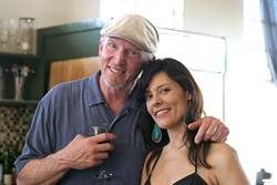 FAST FRIENDS :  Sustenance proprietor Seamus Finn-Chandler and Stacie Benefield, who traveled from Oregon to see the show, cozy up for a photo. - PHOTO BY GLEN STARKEY