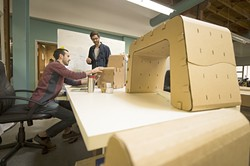 """NOT JUST PAPER:  From left, """"Cardboard Guys"""" Jake Disraeli (left) and Justin Farr (right) work on their startup at SLO HotHouse. - PHOTO COURTESY OF SLO HOTHOUSE"""