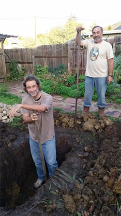 DIGGING THE PIT:  Ray Lee (left) and Keith Pellemeier helped dig the roasting pit. - PHOTO BY GEORGE GRIFFIN AND GLEN STARKEY