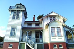 HAUNTED LIGHTHOUSE?:  The 1890 lighthouse keeper's quarters and light tower may look picturesque during the day, but restoration workers reported hearing spirits at the site, prompting the CCPI's investigation. - PHOTO BY RHYS HEYDEN