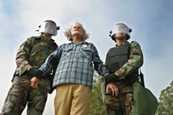 PROTESTING WAR :  March 27, 2003. Sanderson Beck protests at Vandenberg Air Force Base. - PHOTO BY CHRISTOPHER GARDNER