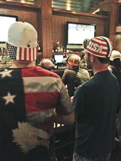 BROS-R-US:  Even in the dark bar, it was hard to miss the omnipresent Stars and Stripes attire. - PHOTO BY RHYS HEYDEN