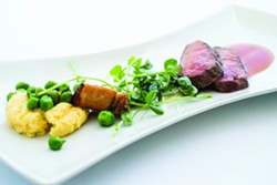 DELICIOUS :  Apple Farm Chef Steven Smeets creates lamb loin with polenta, pork belly, peas, and tomato gastrique.