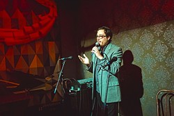 ROCK THE MIC:  Kreuzberg Lounge's weekly open mic night turned two years old late last month and continues to unfold each Wednesday from 9 to 11 p.m. hosted by Mitchell Shira (pictured). - PHOTO BY KAORI FUNAHASHI
