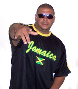 REBEL WITH A CAUSE :  Port Hueneme-based reggae singer Ras Rebel performs on Nov. 21 at Mr. Rick's. - PHOTO COURTESY OF RAS REBEL