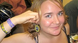 EYE-CATCHING ACCESSORIES :  Emma Teixeira hammered the hell out of beer caps to make a pair of earrings anyone can thirst over. - PHOTO BY NICK POWELL