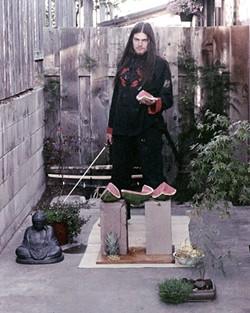 BAD FRUIT :  Reiku Hituero chops watermelon with a katana as a performance art piece. - PHOTO COURTESY OF ART ZERO
