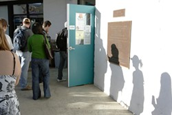 BREAKFAST WITH OBAMA :  Cuesta students line up to enter the inauguration party. - PHOTO BY STEVE E. MILLER