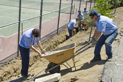 MEN AT WORK :  Inmates at the SLO County Jail's Honor Farm spent a day out in Santa Margarita on May 13, installing a drainage system for the Community Center as part of a pilot program to start an afterschool program for local kids. - PHOTO BY STEVE E. MILLER