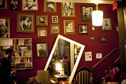 BOOKENDS :  Kreuzberg's couches are rarely empty, and patrons of all ages can find something to sip and read. - PHOTO BY STEVE E. MILLER