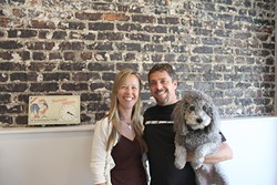 IN THE DOGHOUSE:  Liz and Brian Espy, with Mop the dog, are owners of Doghouse Promotions, a small company specializing in promotional branding that recently relocated to downtown SLO. - PHOTO BY REBECCA LUCAS